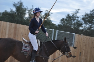 Polo Club Vice President Amelia Hiatt rides during practice. She devotes most of her time to polo activities. Photo by Brittany Lamas
