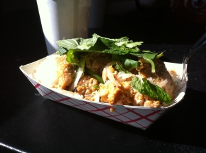 East Side King's Tori Meshi combo features cornmeal fried chicken thighs on a bed of ginger rice.