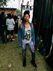 Khadijah plays up galaxy leggings, Doc Martens combat boots and a graphic tee with a bindi gem on her forehead.