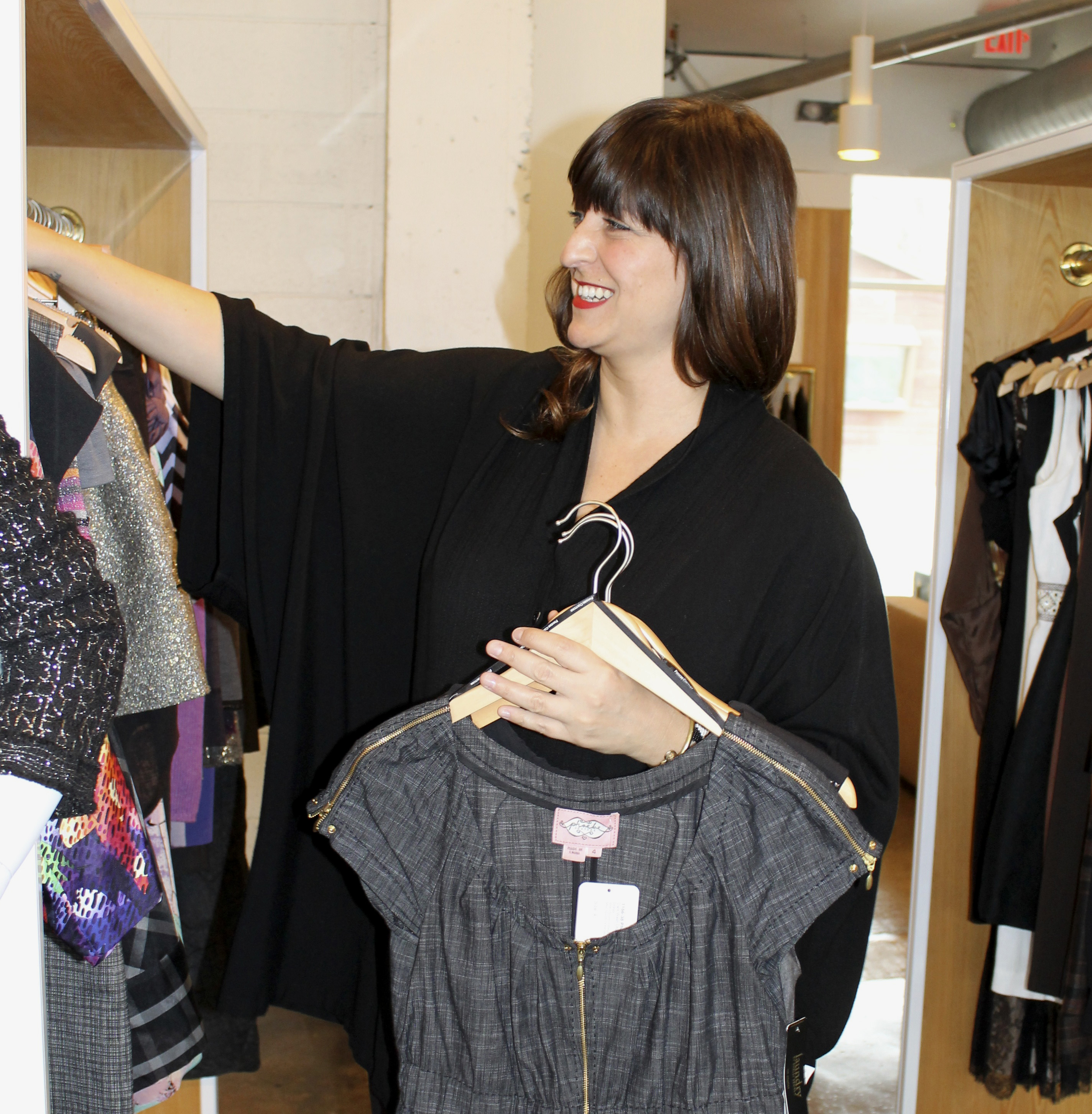 Store manager Sari Warenoff fills the racks with the store's newest goodies