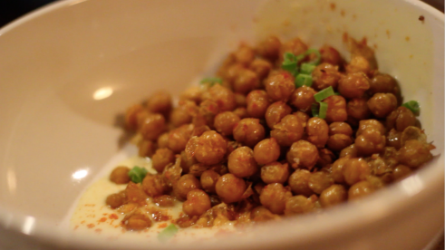The fried chickpeas come to the table topped with marsala on top of a pool of aioli. The Hightower encourages mixing the aioli and the chickpeas well to accent the crunchiness of the appetizer.
