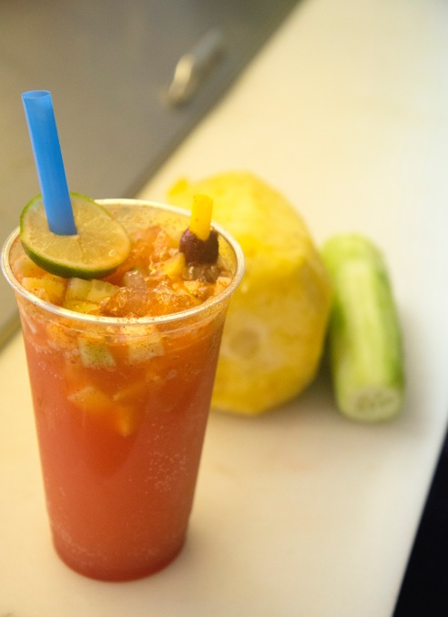 """Known as a """"Rusa,"""" this drink contains Squirt and chili sauce with diced pineapple and cucumber."""