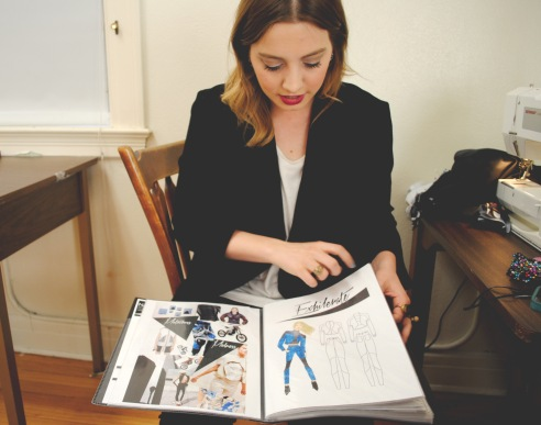 Poché skims through her lookbook. She says she has found lots of inspiration from the Bauhaus Movement.