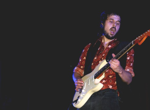 Andrew Martin, guitarist for Moon Honey, shreds the stage with his progressive and funky style.