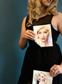 Grant emulates Christina Aguilera by looking to photos of her for inspiration.