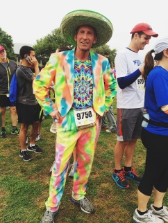 Matt Scherzinger, a UT alumnus of the photojournalism program, brightened up the gloomy morning at the Cap 10k with his colorful costume. This year's race marked Scherzinger's 22nd Cap 10k to participate in.