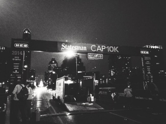 At 5 a.m., the Cap 10k starting line stood in darkness as crew members prepared for the many runners that would soon cross it.