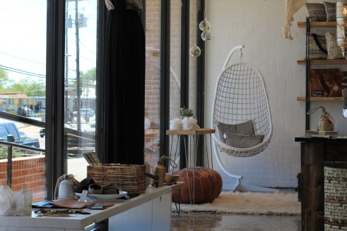 Raven + Lily's storefront completes its laidback atmosphere with natural decorative elements and comfortable seating.