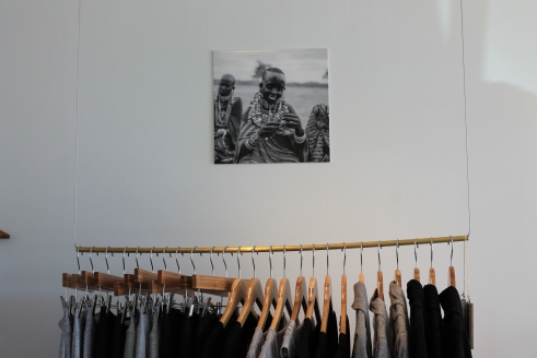 Photos of Raven + Lily artisans hang throughout the store.