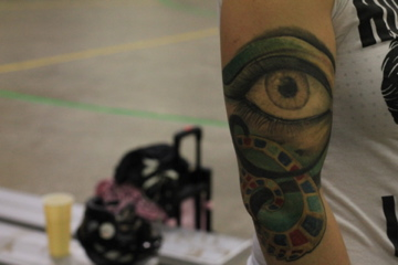 Boss' tattoo, the Eye of Horus, marks the place where her humerus broke in half.