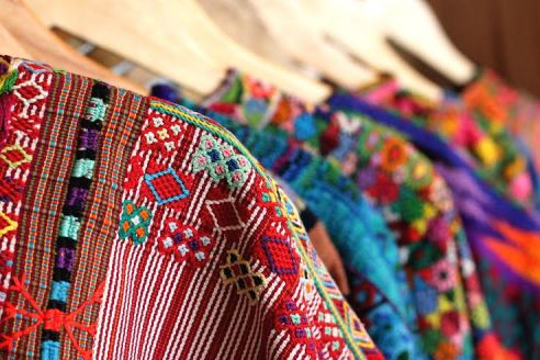 "Shirts fashioned from ""mola"" textiles by Teysha"