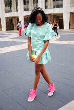 Candace Marie of Marie Mag radiates cuteness in a pastel pleated dress with bubblegum pink high-top sneakers. @marie_mag_