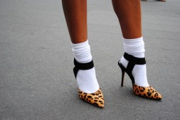 A sock craze was spotted all around New York City. Here they are paired with Steven Madden leopard pumps.