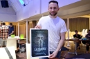 Matt Devillier, husband of director L. M. Harter, holding a poster from Galt Productions' La Llorona.