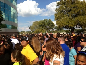 A crowd of over 20,000 people gathers outside the entrance of the Alamodome 15 minutes before doors open for the One Direction concert September 21. Fans started arriving at the venue up to 6 hours before the show.