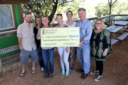 Members of Howry Breen and Herman LLP present a grand check of $20,363 to officials of the Austin Zoo and Animal Sanctuary. Photo by Ceci Gonzales.