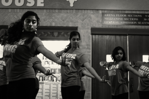 Members of the Nritya Sangam Troupe, dance in sync while practicing their new routine.