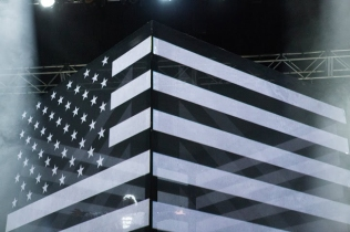 Outkast's Friday set opened up with a black and white American flag with a street sign posted in the middle.