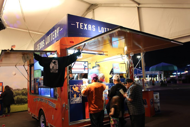 The Texas Lotto tent attracts many to test their luck and see if it pays off.