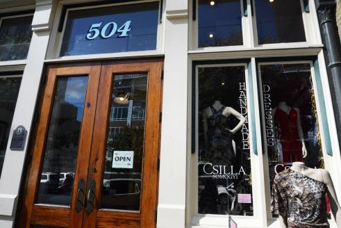 The double wooden doors of Csilla Somogyi's eclectic boutique on Congress and 5th.