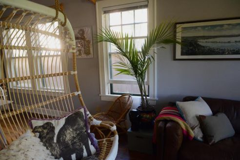 Bamboo furniture and ferns complement modern furniture and decoration.