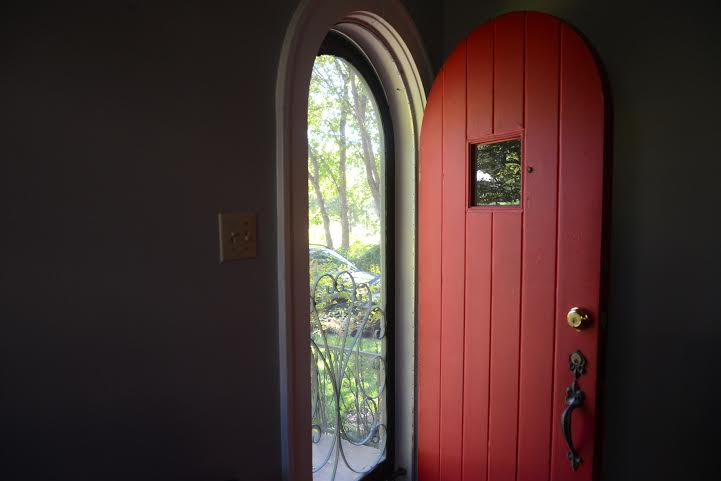 A red, wood door warmly invites guests into Kunas' home on Hemphill.
