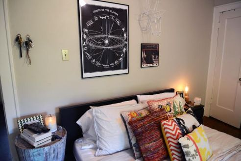 Kunas likes to keep it simple in her bedroom-- she decorates her white and beige colored bedroom with colorful,  patterned pillows.