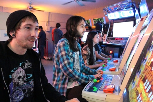 Arcade UFO regulars lined up at their go-to games on a Saturday night.