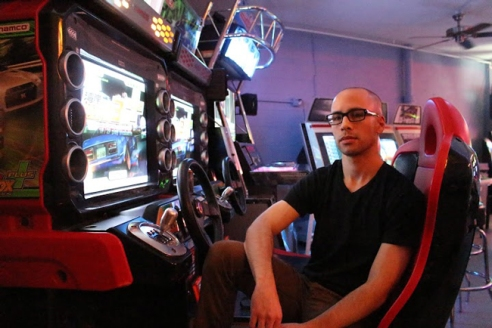 UT grad and Arcade UFO founder, Ryan Harvey, takes a break from his managerial duties to kick back in his arcade.