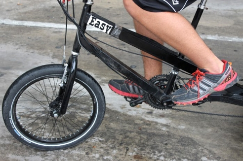 Garcia sports a pair of comfortable running shoes, an essential for pedicab driving.