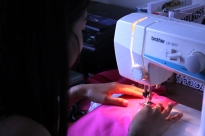 Jackie usually works on campus, but she has her mother's sewing machine handy in case of emergencies!