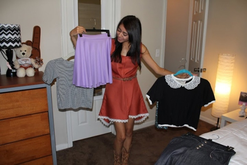 Jackie excitedly drapped herself in the clothes she made to show off her collection in style!