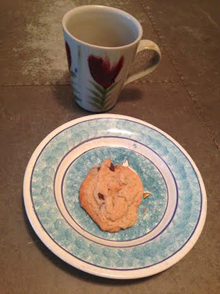 Chocolate chip mug cookie and a mug of British tea.