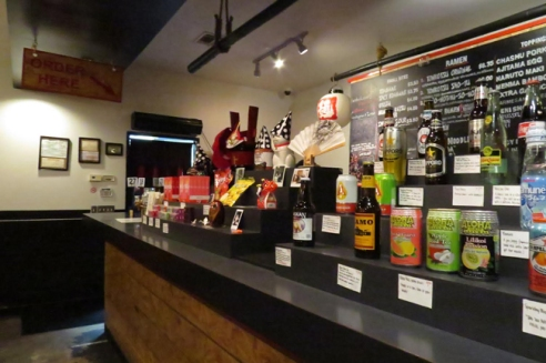 While waiting in line, customers can glance over the menu or choose from a selection of Japanese beer on display.