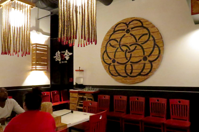 Wooden decor adorns the walls of Ramen Tatsu-Ya, along with black, white and pops of red throughout.
