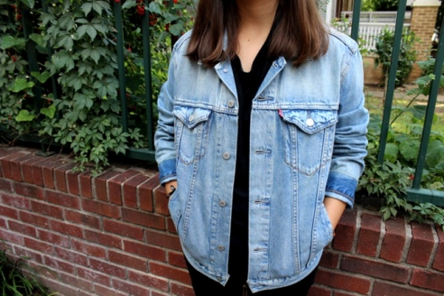 A light wash denim jacket layered with a dark tee gives the perfect fall contrast.