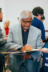 Arun Gandhi signing a book right after the panel.
