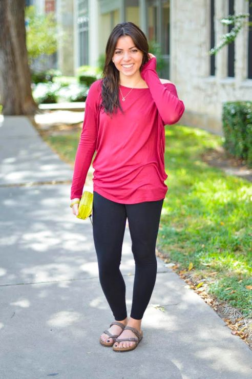 Valentina Melo, sophomore, looks cute and casual in her black Athletica leggings and slouchy Francesca's long sleeve top. Paired with Mayari Birkenstocks, this outfit is perfect for rolling out of bed and making it to class in style.