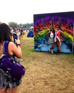 Festivalgoers at Austin City Limits on Oct. 12, 2014 take pictures before a work created by SprATX collective member David Lowell. The piece was part of a larger installation of works completed by local street artists for the popular music festival.