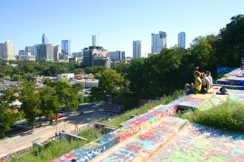 A group observes the Austin skyline as they picnic on the remains of a failed development project turned public art venue on Oct. 7, 2014. The Hope Outdoor Gallery, which sits at 11th and Baylor Street in downtown Austin, provides a safe space for anyone to express themselves through the medium of street art.