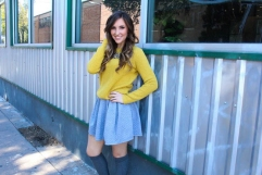 Reagan Sansom goes for a sweet and preppy look by pairing this classical sweatshirt-inspired gray skirt with an embellished mustard sweater. New Haven Cyrstal Bib mustard sweater: $42.00 Grey Quilted Flair Skirt- $32.99 Cognac Ponder Open Panel Booties- $38.99