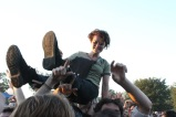 A festival goer crowd surfs during Black Lips' set.