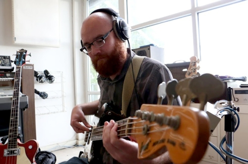 John French of MODAL plays the Bass Guitar during a recording session for their new album.