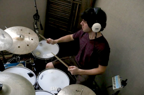 Alex Ogle of MODAL bangs the drums during a recording session for their new album.